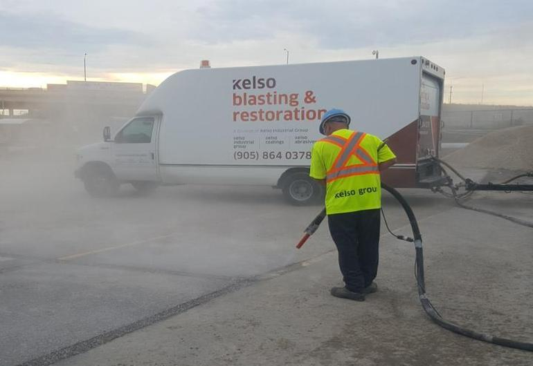 Pavement line removal with abrasive blasting